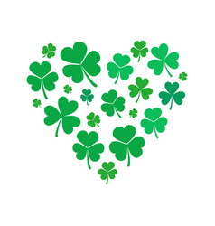 Heart made of small shamrock or clover vector