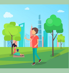 man walks in park with smartphone and headphones vector image