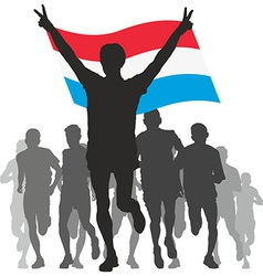 Winner with the Luxembourg flag at the finish vector image vector image