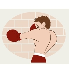 Young boxer in red shorts trained against a brick vector