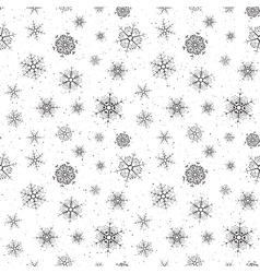 Seamless background of snowflakes vector image