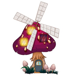 A big mushroom house with a windmill vector image