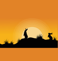 Silhouette of bunny on the hill at sunset vector