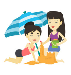 two friends building sandcastle on beach vector image