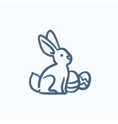 Easter bunny with eggs sketch icon vector image