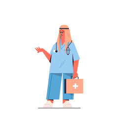 arab male doctor in uniform holding first aid kit vector image