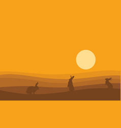 Silhouette of bunny on desert at sunset vector