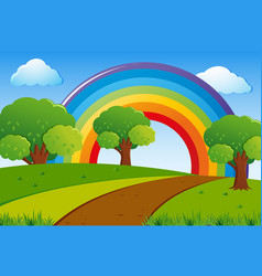 scene with green lawn and rainbow in sky vector image