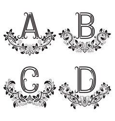 A b c d vintage monograms in floral wreaths vector