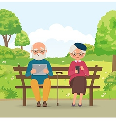 Elderly couple in the park with gadgets vector image