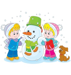 Children making a snowman vector image