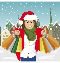 young woman in santa hat holding shopping bags vector image vector image