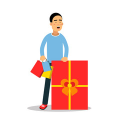 young man standing with purchases and huge red vector image