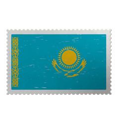 Kazakhstan flag on old postage stamp vector