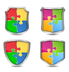 Shields with puzzle pieces vector image vector image