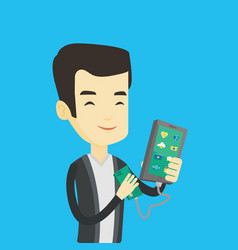 man reharging smartphone from portable battery vector image
