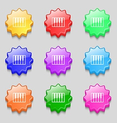 piano key icon sign symbol on nine wavy colourful vector image