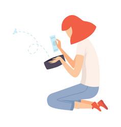 teen girl sitting on floor and looking into wallet vector image