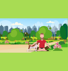 Poor bearded man with dog sitting in urban park vector