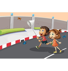 Kids catching butterflies at the street vector image