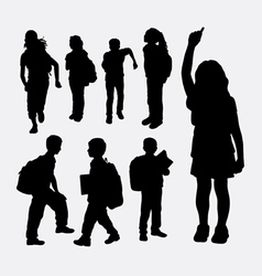 school girl and school boy silhouette vector image