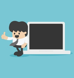 Businessman with thumb up leaning against laptop c vector
