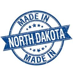Made in North Dakota blue round vintage stamp vector