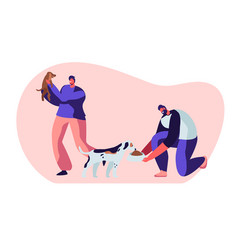 Happy people with dogs feeding playing with puppy vector