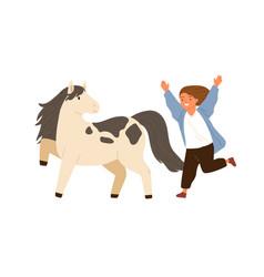 Joyful little girl running to hug adorable pony vector