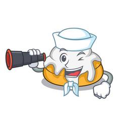 Sailor with binocular cinnamon roll mascot cartoon vector