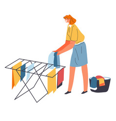 woman hanging washed wet clothes for drying vector image