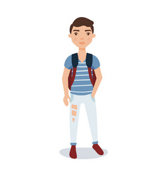 Young man in a blue shirt ripped jeans standing vector