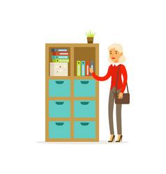 Senior woman standing in the office over folder vector