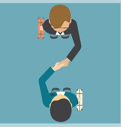 top view of two people shaking their hands vector image vector image