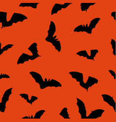 halloween orange background with bats silhouettes vector image