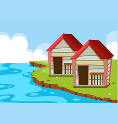 two huts by the river vector image