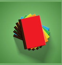 Realistic colorful books with green background vector