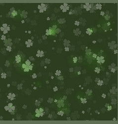 Shine shamrocks on black background seamless vector
