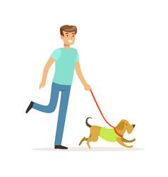 Young smiling man walking a dog vector
