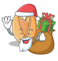 Santa with gift pistachio nut mascot cartoon vector