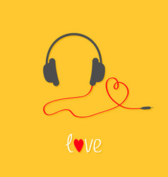 headphones and red cord in shape of heart white vector image vector image