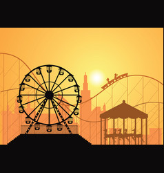 Silhouettes of a city and amusement park vector