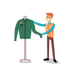 male dressmaker working at sewing atelier fashion vector image