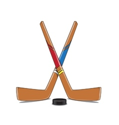 Crossed Hockey Sticks and Puck vector image