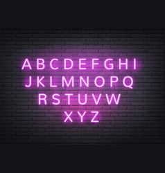neon alphabet retro letters on brick wall vector image