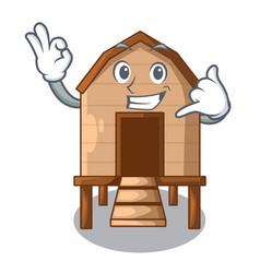 Call me chicken in a wooden cartoon coop vector