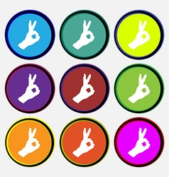 Gesture ok icon sign Nine multi colored round vector image