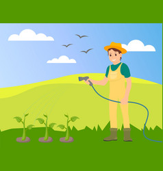 woman farmer in uniform watering plants at the vector image