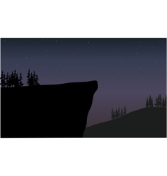 Silhouette of cliff at night scenery vector