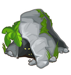 Stone cave with creatures looking out vector